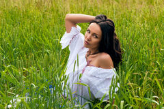 Portrait of beautiful woman in the field Royalty Free Stock Images