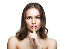 Portrait of beautiful woman with finger on lips, isolated Stock Photos