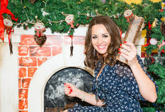 Portrait of beautiful woman by fireplace in Christmas. Portrait of beautiful woman by fireplace in the Christmas stock photo
