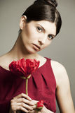 Portrait of a beautiful woman with  a flower Stock Images