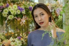 Portrait of a beautiful woman with a flower arch stock photo