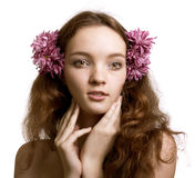 Portrait of beautiful woman with flower in hair Stock Image