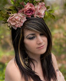 Flower Child. A portrait of a beautiful woman with a flower headband Royalty Free Stock Images