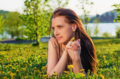 Portrait of a beautiful woman on a flower meadow Royalty Free Stock Images