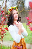 Portrait beautiful woman with flower wreath in the colorful autumn park Royalty Free Stock Photography
