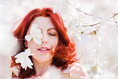 Portrait of a beautiful woman with flowering tree. Portrait of a beautiful woman in a flowering magnolia tree Royalty Free Stock Images