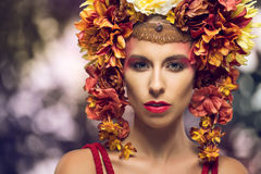Portrait of a beautiful woman with flowers Stock Photos