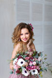 Portrait of a beautiful woman with flowers Royalty Free Stock Image