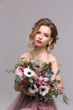 Portrait of a beautiful woman with flowers Stock Photography