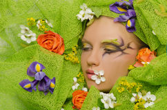 Portrait of beautiful woman in flowers Stock Image