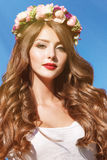 Portrait of a beautiful woman with flowers in her hair Stock Photography
