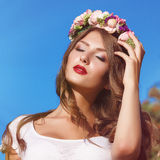 Portrait of a beautiful woman with flowers in her hair Royalty Free Stock Photos