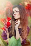 Portrait of a beautiful woman in flowers outdoors. Portrait of a beautiful woman in flowers royalty free stock images
