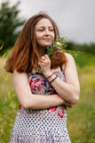 Portrait of a beautiful woman with flowers royalty free stock images
