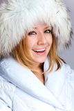 Portrait of a beautiful woman in the fur coat Stock Photos