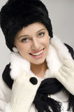 Portrait of a beautiful woman with fur winter hat and coat. Stock Image