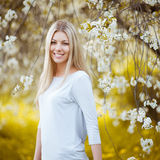 Portrait of a beautiful woman in the garden Stock Photography