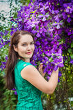 Portrait of a beautiful woman in a garden Royalty Free Stock Photo