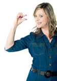 Portrait of beautiful woman gesturing small bit Royalty Free Stock Photos