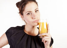 Portrait of beautiful woman with a glass of juice royalty free stock images