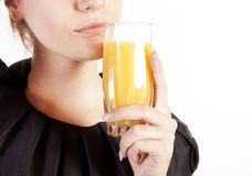 Portrait of beautiful woman with a glass of juice Stock Photography