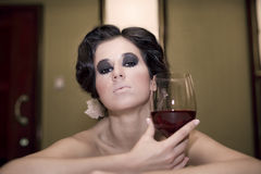 Portrait of beautiful woman with glass red wine Stock Photos