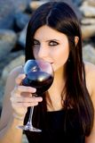 Portrait of beautiful woman with glass of wine looking Stock Photo