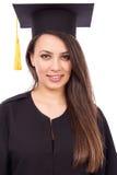 Portrait of a beautiful woman graduate wearing a graduation gown Stock Photos