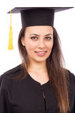 Portrait of a beautiful woman graduate wearing a graduation gown Royalty Free Stock Photo