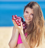 Portrait of beautiful woman with grapes in hands in summer outdoor Royalty Free Stock Photo