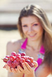 Portrait of beautiful woman with grapes in hands i Stock Photography