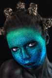 Portrait of beautiful woman with green and blue sparkles on her Royalty Free Stock Images