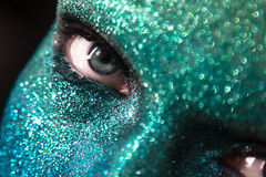Portrait of beautiful woman with green and blue sparkles on her Stock Image