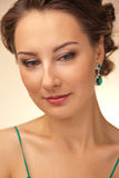 Portrait of beautiful woman with green earrings Stock Images