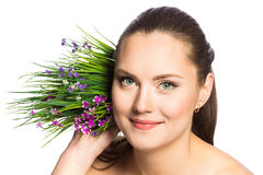 Portrait of beautiful woman with green eyes and spring flowers Stock Photography