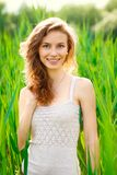 Portrait of beautiful woman in green grass Royalty Free Stock Photos