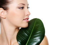 Portrait of a beautiful woman with green leaf Royalty Free Stock Image