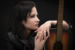 Portrait of a beautiful woman with a guitar Royalty Free Stock Photo