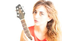 Portrait of a beautiful woman with guitar in her hand Royalty Free Stock Images