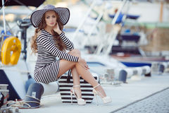 Portrait of beautiful woman in hat on the pier royalty free stock image