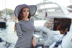 Portrait of beautiful woman in hat on the pier royalty free stock photo