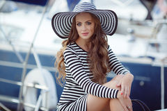 Portrait of beautiful woman in hat on the pier stock photography