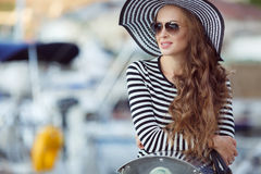 Portrait of beautiful woman in hat on the pier stock photos