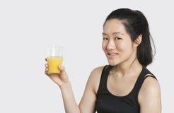 Portrait of a beautiful woman having a glass of orange juice Stock Image
