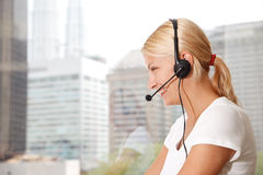 Portrait of a beautiful  woman with headset Stock Photography
