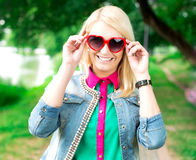 Portrait of beautiful woman in heart shape glasses stock images
