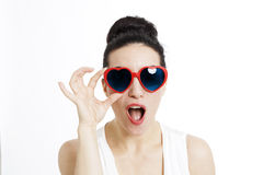 Portrait of a beautiful woman with heart shaped glasses Stock Images