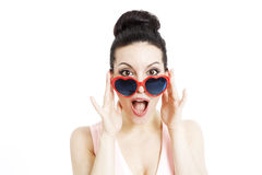 Portrait of a beautiful woman with heart shaped glasses Royalty Free Stock Photo