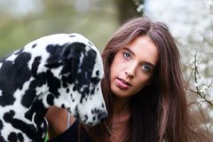 Portrait of a beautiful woman with her Dalmatian dog. Portrait of a beautiful young woman with her Dalmatian dog Stock Images