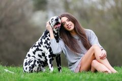 Portrait of a beautiful woman with her Dalmatian dog Stock Photography